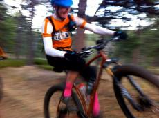 A rare shot of me riding and trying to wheelie. Photo by Laura of Soulrun.