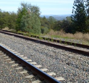 tracks with the Foresthill Divide in the distance